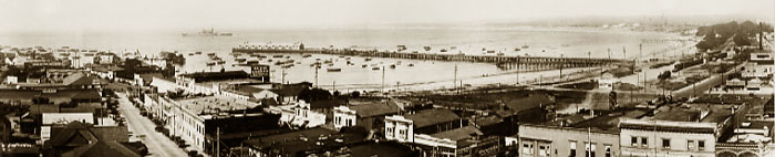 A.C. Heidrick photographer,with a navy ship in Monterey Bay from roof of San Carlos Hotel. Circa 1930   76-009-0001 ©2003 California Views